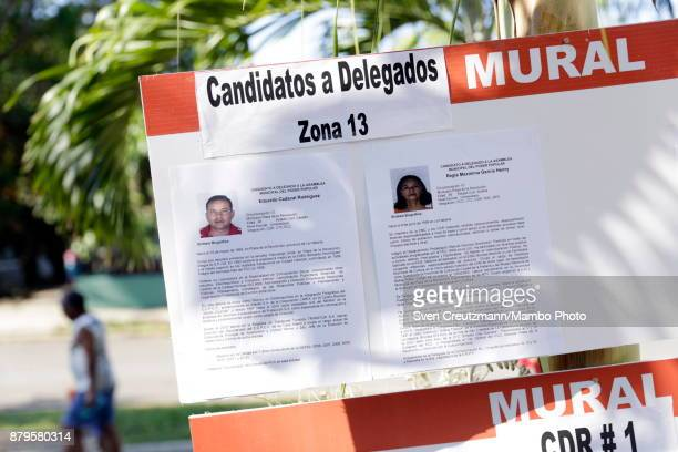 Photos and vitae of two candidates are at display in front of the premise where Revolution leader Fidel Castro used to cast his vote on occasion of...