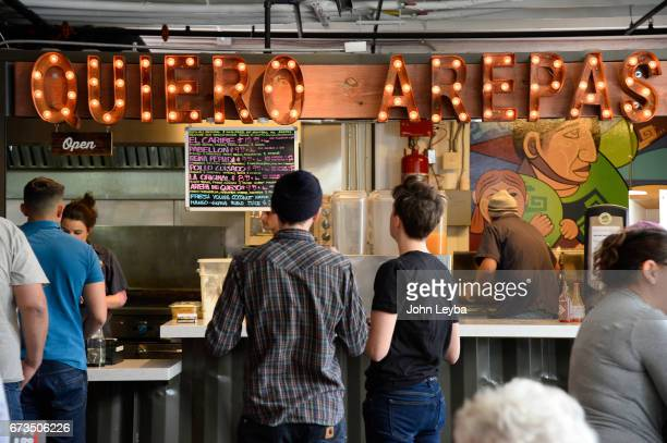 Photos at American Grind and Quiero Arepas at the Avanti food hall on April 26 2017 There are 5 restaurants on the main level and two on the upper...