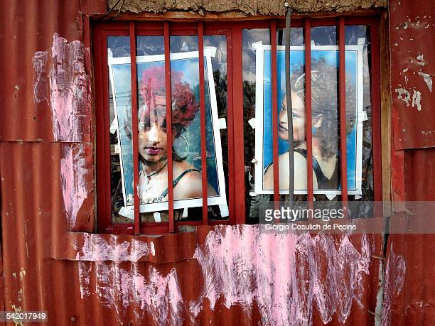 Photos hung behind a window of a hut in Addis Ababa Ethiopia