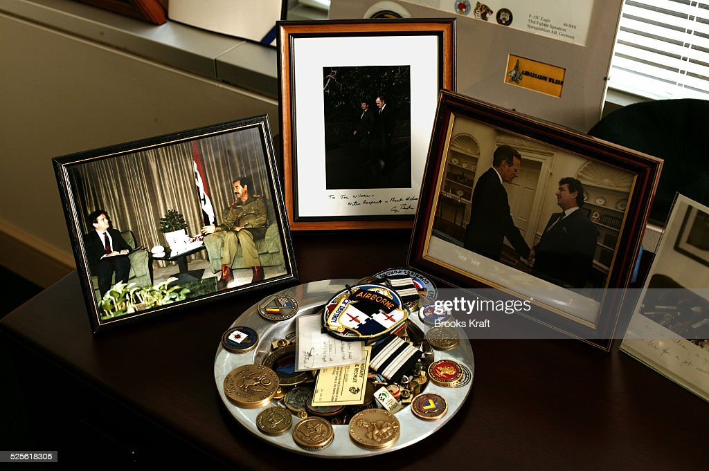 Photos line the desk of former ambassador Joseph C Wilson IV's Washington DC law office Wilson was asked to look into claims Saddam Hussein sought...