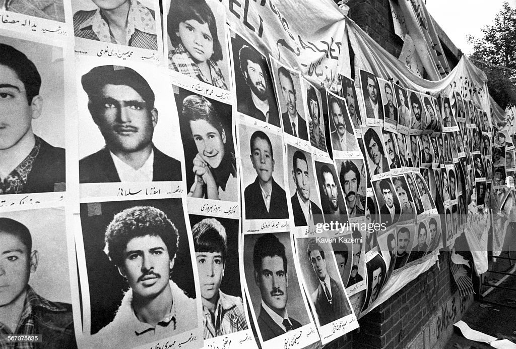 Photos of alleged martyrs of the Iranian Revolution are displayed on the wall outside the American Embassy which is occupied by students following...