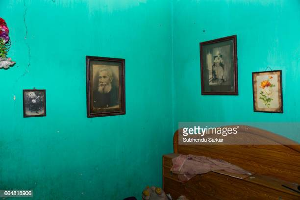 MCCLUSKIEGUNJ RANCHI JHARKHAND INDIA Photos of AngloIndian ancestors adorn the wall of the room of Kitty Texeria one of the AngloIndians living at...