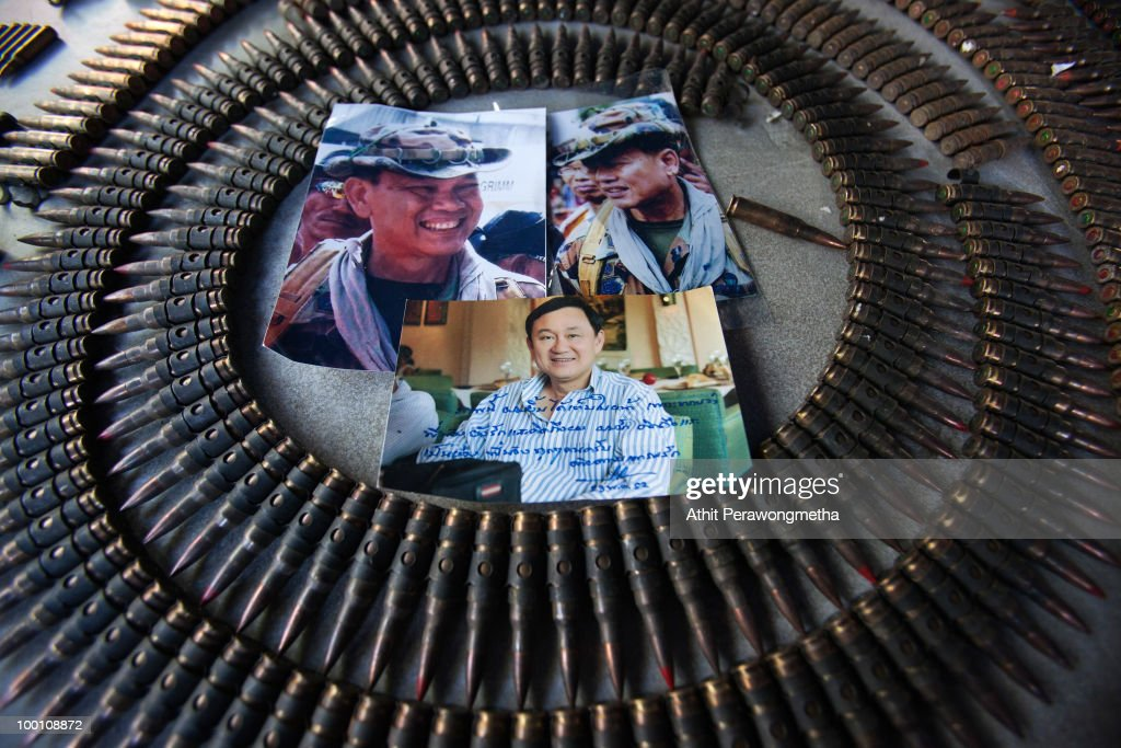 Photos of former Prime Minister Thaksin Shinawatra, Major-General Khattiya Sawasdipol and weapons sized from anti-government protesters 'Red shirt' are displayed at a Temple near their encampment on May 21, 2010 in Bangkok, Thailand. Thai Prime Minister Abhisit Vejjajiva says order has been restored to the capital Bangkok and throughout the country. A night-time curfew remains in place in Bangkok and 23 provinces are to prevent a resurgence of unrest. At least 44 people have been killed in clashes in which protesters clashed with military forces over a period of six consecutive days, resulting in the end of the blockade and the surrender of Red-shirt leaders.