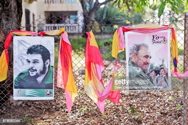 Photos of late Revolution leader Fidel Castro and Che Guevara are at display in front of the premise where Castro used to cast his vote on occasion...