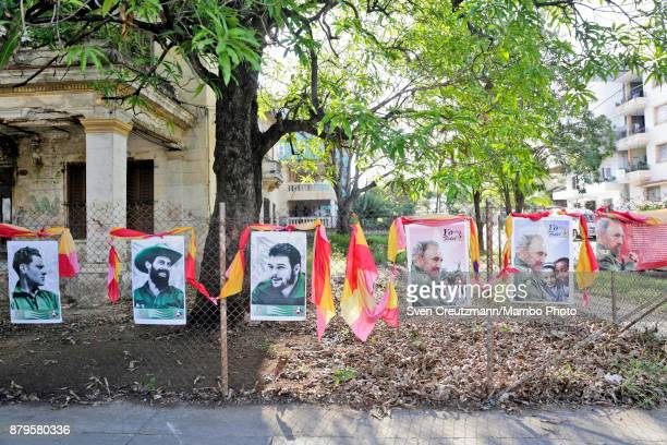 Photos of late Revolution leader Fidel Castro Che Guevara Camilo Cienfuegos and Antonio Mella are at display in front of the premise where Castro...