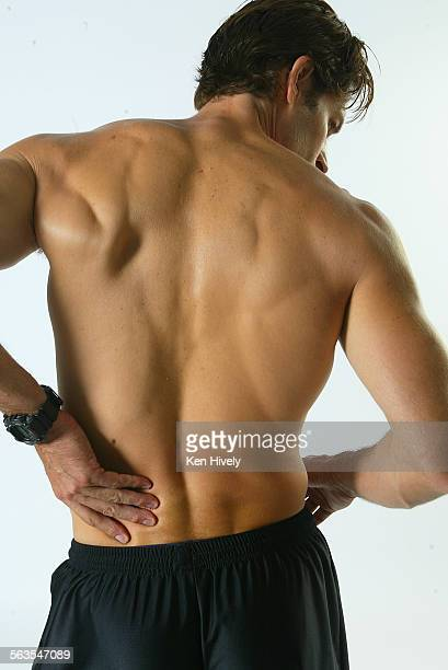 Photos of model working out on weights lower back pain September 24 2003