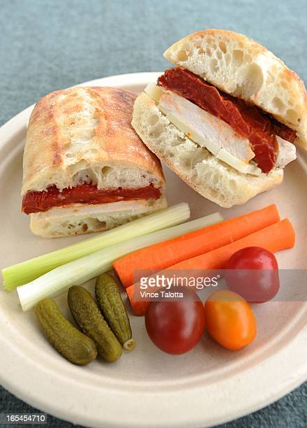 Photos of picnic foods Grilled Chicken Sandwiches with OvenDried Tomatoes and Manchego Moroccan Couscous Salad with Zucchini Apricots and Almonds and...