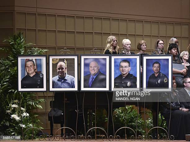 Photos of the victims of the Dallas police shooting are seen during an interfaith memorial service at the Morton H Meyerson Symphony Center on July...