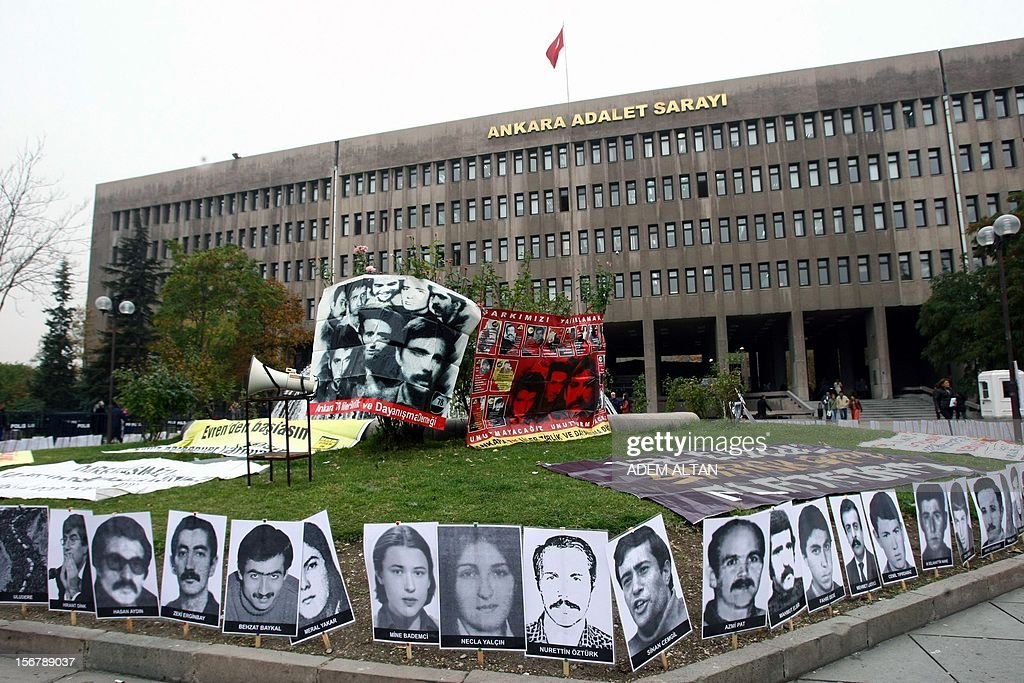 Photos of the victims of Turkey's 1980 military coup are displayed outside the couthouse as the trial of the two surviving leaders of Turkey's 1980 military coup continues in Ankara, on November 21, 2012. Kenan Evren, 94, who served as president after the military takeover, and Tahsin Sahinkaya, 86, the former air force commander defended today their takeover as 'patriotism,' on the second day of a landmark trial where they again appeared by video link.. Some 300 people demonstrated Tuesday outside the Ankara court urging authorities to severely punish the two retired generals.