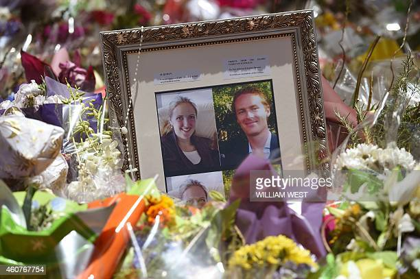 Photos showing Katrina Dawson and Tori Johnson sit amongst the floral tributes left outside the Lindt cafe in Sydney's Martin Place one week after a...
