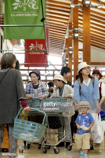 Photos shows the new Ishinomaki Genki Market shopping center after its opening on June 30 in the tsunamihit northeastern Japan city of Ishinomaki The...