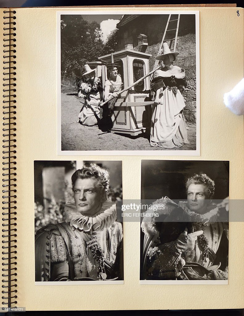 Photos, taken by photographer Aldo Graziati, of French actor Jean Marais, playing in scenes of Jean Cocteau's movie 'La Belle et la Bete' (Beauty and the Beast), are shown on September 19, 2013 in Paris.