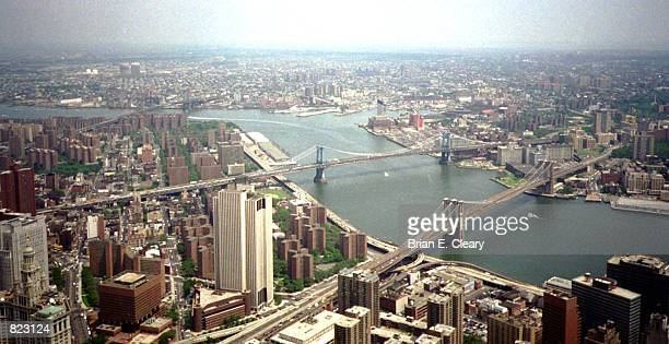 The Brooklyn Bridge and the Manhattan Bridge span the East River in this view from atop the World Trade Centerin July 1995