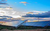 Photovoltaic and wind plant at sunset for the generation of electrical energy