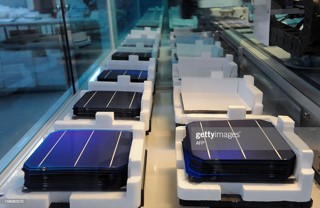 Photovoltaic cells are displayed on an assembly line at MPO Energy plant in Averton, western France, on January 7, 2013. AFP PHOTO/JEAN-FRANCOIS MONIER.