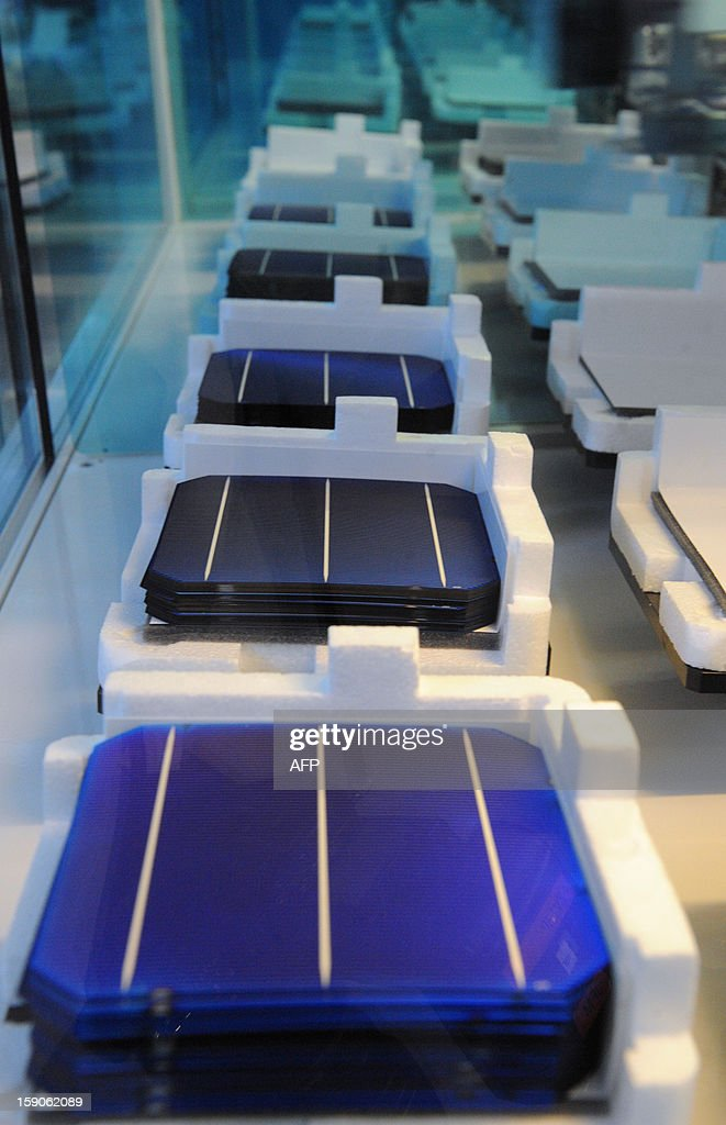 Photovoltaic cells are displayed on an assembly line at MPO Energy plant in Averton, western France, on January 7, 2013.