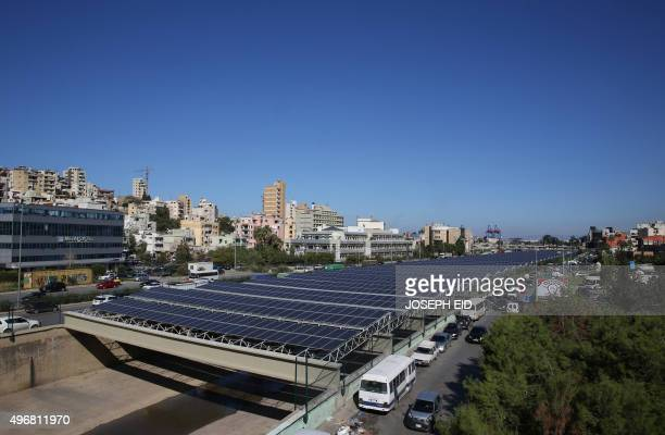 Photovoltaic panels are seen above the river bed in the Lebanese capital Beirut on November 12 2015 As part of the government's National Energy...