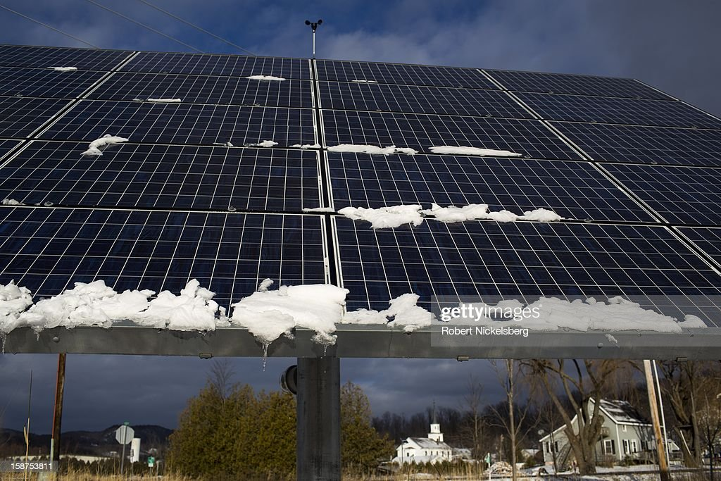 Photovoltaic panels track and rotate along the path of the sun December 24, 2012 in Hinesburg, Vermont.