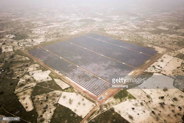 Photovoltaic solar panels sit in an array at the Senergy Santhiou Mekhe PV solar plant in this aerial photograph taken in Thies Senegal on Monday Oct...