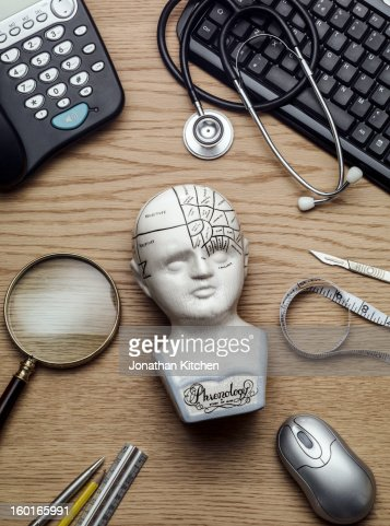 Phrenology Head on a doctors head front on : Stock Photo