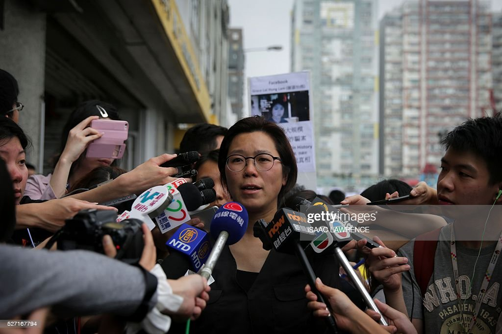 Phyills Tsang (C), Ming Pao Staff Association Chairwoman, speaks to the media after a rally organised by Journalist groups to protest the sacking of Ming Pao's Executive Chief Editor Keung Kwok-yuen in Hong Kong on May 2, 2016. / AFP / ISAAC