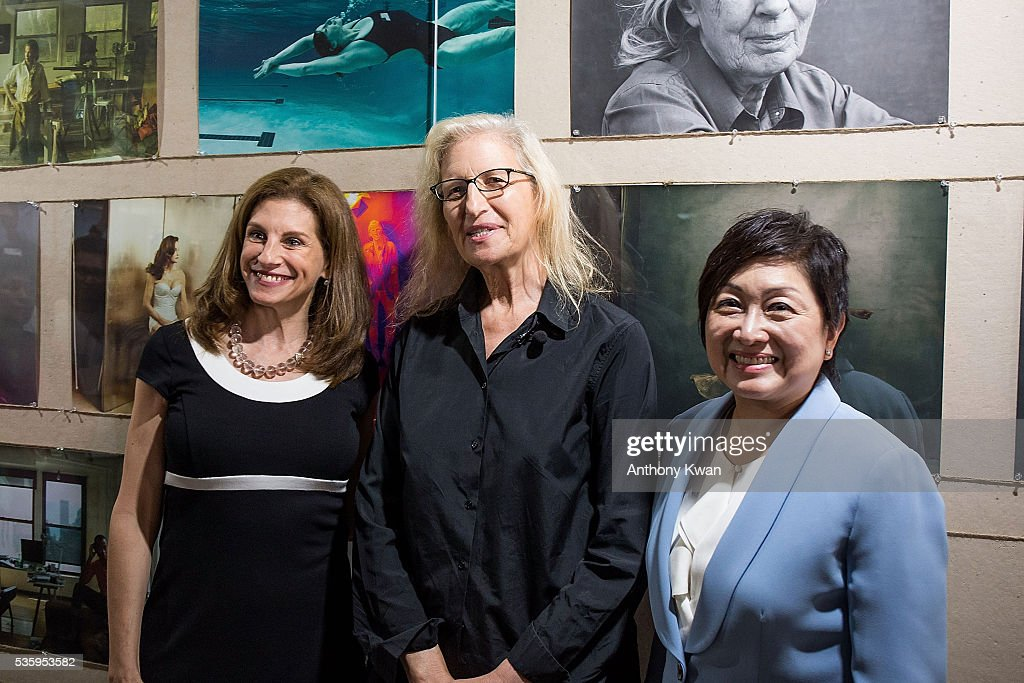 Phyllis Costanza, CEO UBS Optimus Foundation, photographer Annie Lebovitz and President of UBS Asia Pacific Kathryn Shih pose at the Annie Lebovitz's UBS commissioned exhibition, 'WOMEN: New Portraits', to be held at Cheung Hing Industrial Building, Kennedy Town in Hong Kong 3 - 26 June 2016, on May 31, 2016 in Hong Kong.