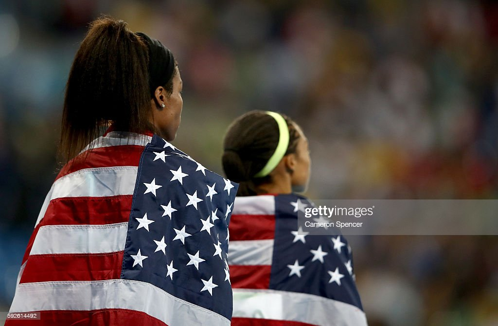 Phyllis Francis (L) of the United States and teammate Allyson Felix look on after winning gold in the Women's 4 x 400 meter Relay on Day 15 of the Rio 2016 Olympic Games at the Olympic Stadium on August 20, 2016 in Rio de Janeiro, Brazil.