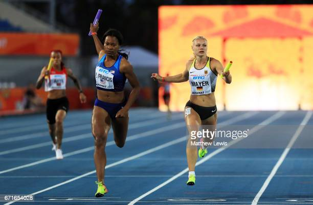 Phyllis Francis of the USA and Lisa Mayer of Germany run in Heat One of the Women's 4 x 200 Meters Relay during the IAAF/BTC World Relays Bahamas...