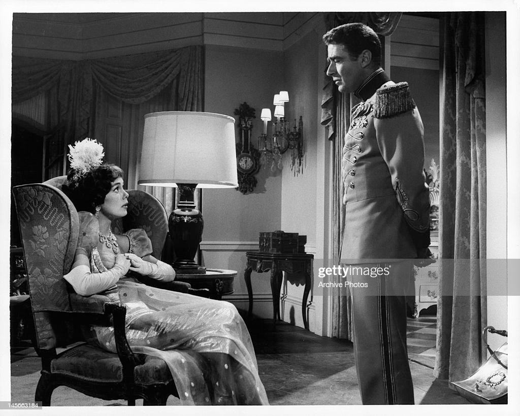 Phyllis kirk and peter lawford talking to each other at fancy dress ball in a