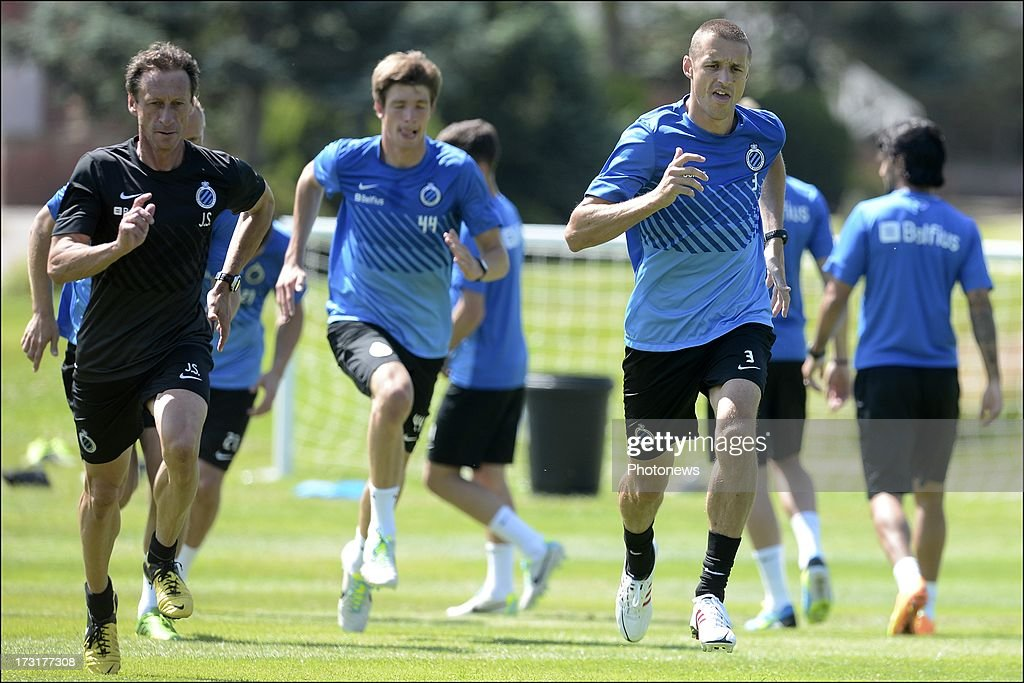 Physical coach Jorge Simo and Timmy Simons in action during the second day of a Club Brugge summer camp training session on July 9, 2013 in Manchester, England.