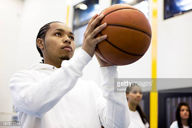 physical education: basketball player focusing on taking a penalty