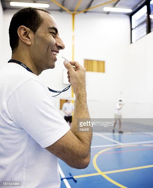 physical education: sports coach about to blow his whistle