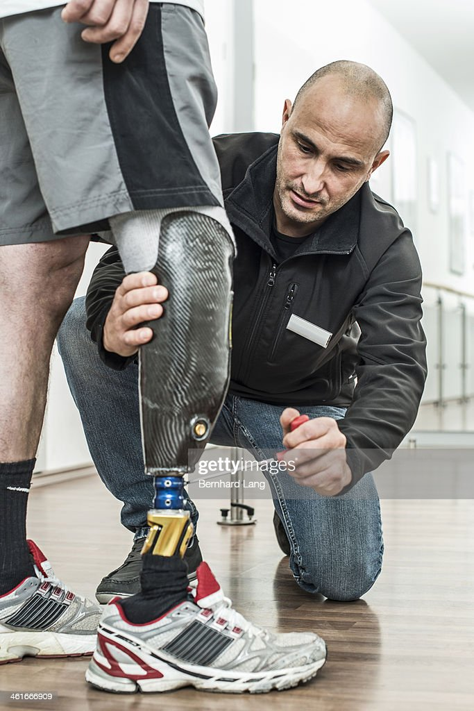 Physical therapist adjusting artificial limb