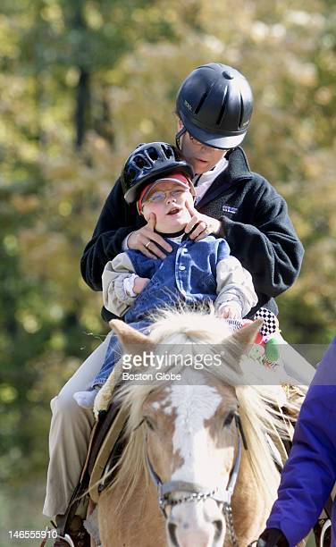 Physical therapist Amy Bolyard and Ryan Barrett of Peabody ride Telleman during a physical therapy program using horses to help with balance at the...