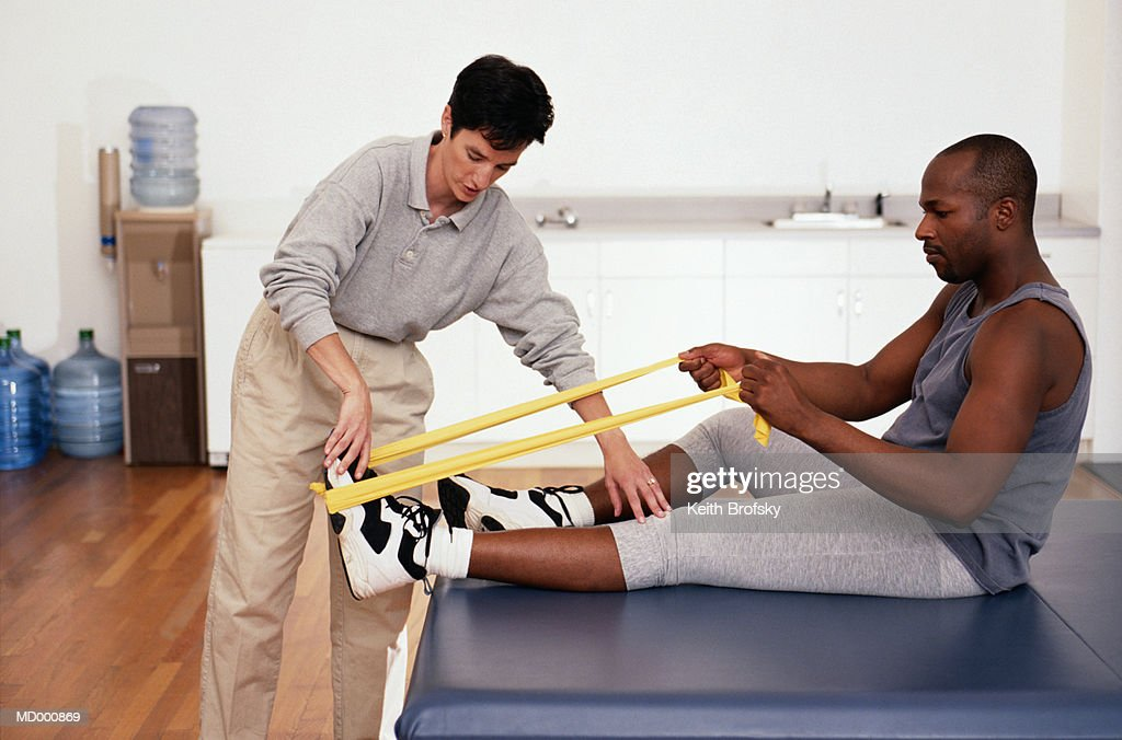 Physical Therapist Helping a Patient : Stock Photo