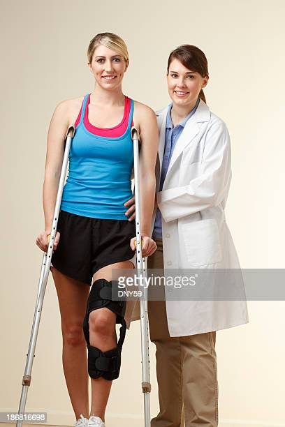 Physical therapist instructing patient on proper use of crutches