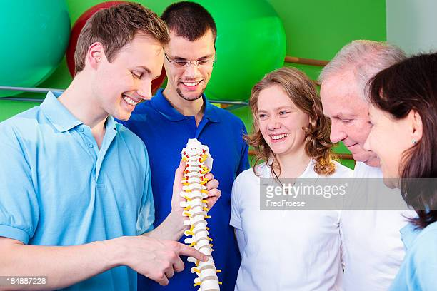 Physical Therapist, Patient and Students standing together