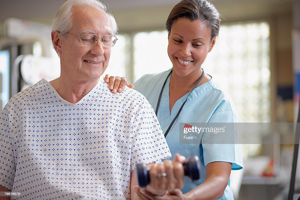 Physical Therapist with Senior Male Patient : Stock Photo
