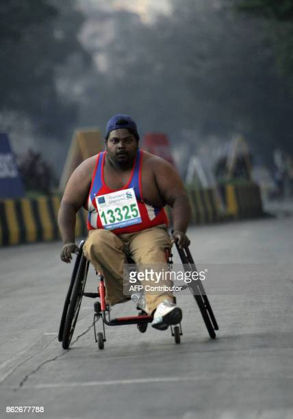 A Physically challeneged man makes his way to the finishing line in the Standard Chartered Mumbai Marathon race in Mumbai 20 January 2008 John Kelai...