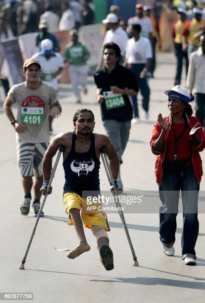 A physically challenged man makes his way to the finishing line in the Standard Chartered Mumbai Marathon race in Mumbai 20 January 2008 John Kelai...