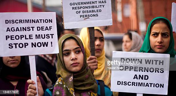 Physically challenged students hold placards during a protest against government on World Disability Day on December 3 2011 in Srinagar the summer...
