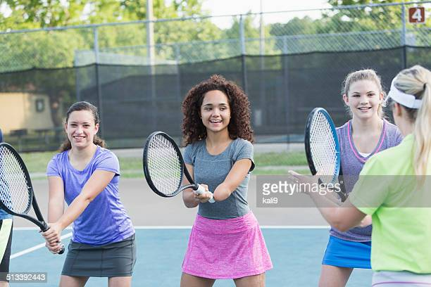 Physically challenged teenage girl playing tennis