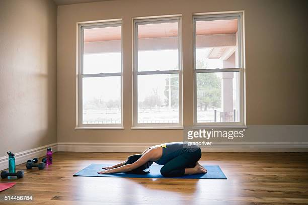 Physically Fit Young Woman Practicing Yoga Childs Pose Living Ro