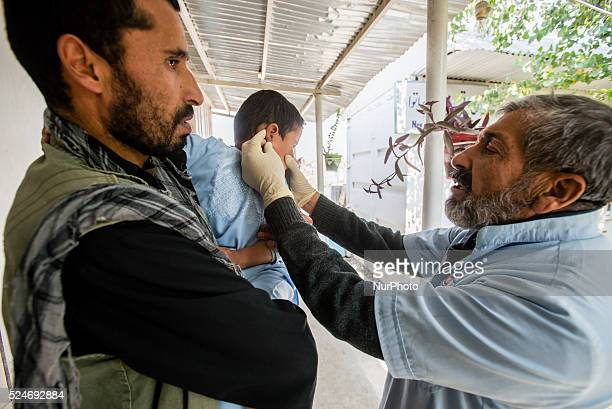 Physician calming baby crying after injection against leishmaniasis most common infection in Afghanistan in leishmania department of Central Hospital...