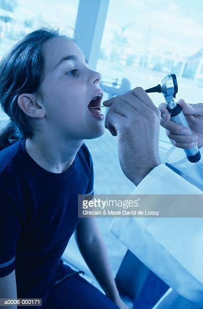 Physician Examining Girl