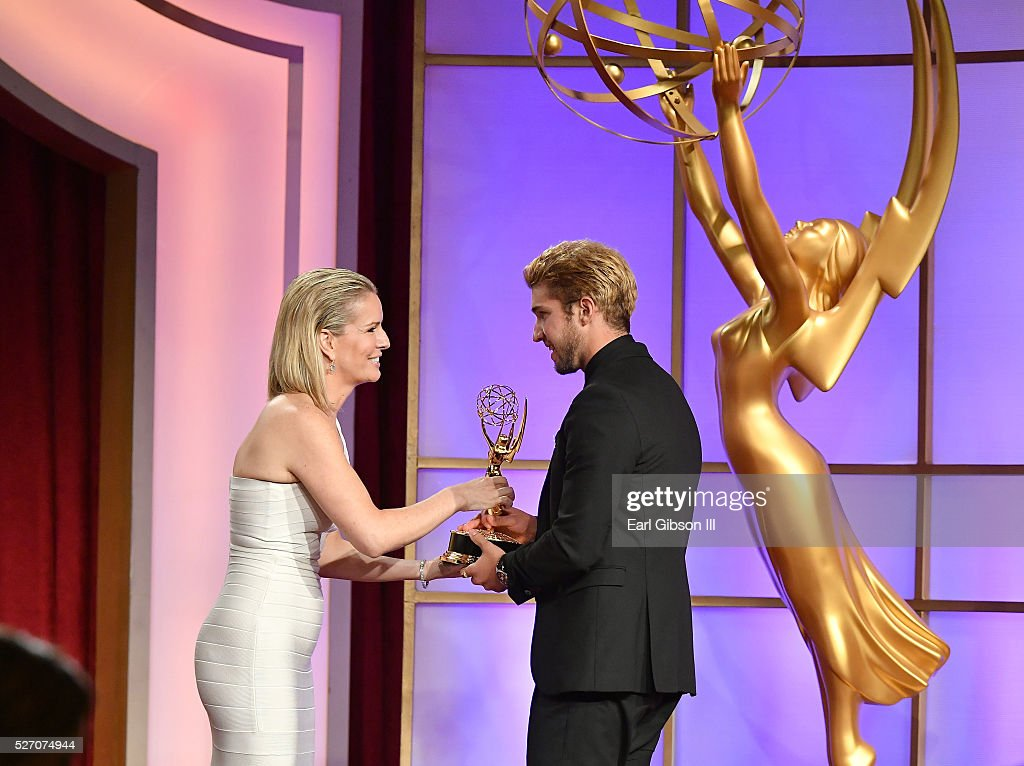 Physician Jennifer Ashton (L) presents Actor <a gi-track='captionPersonalityLinkClicked' href=/galleries/search?phrase=Bryan+Craig&family=editorial&specificpeople=8088252 ng-click='$event.stopPropagation()'>Bryan Craig</a> an Emmy for Outstanding Younger Actor in A Drama Series on stage at the 43rd Annual Daytime Emmy Awards at the Westin Bonaventure Hotel on May 1, 2016 in Los Angeles, California.