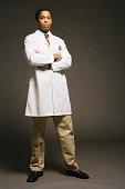 Physician on black background, portrait