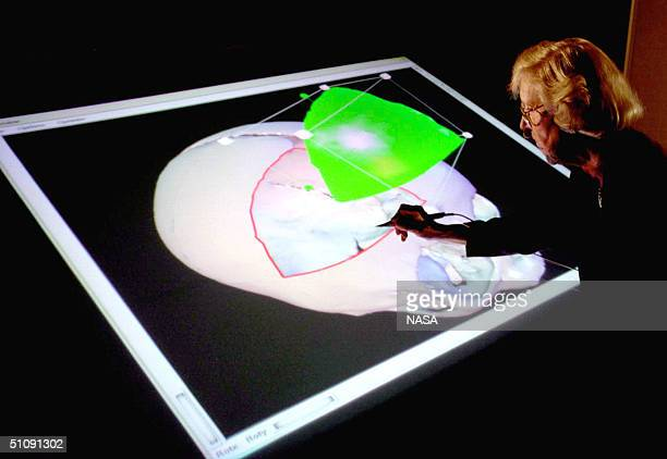 Physician Wearing 3D Glasses Looks At A RearProjected Computerized Image Of A Patient's Head On An 'Immersive Virtual Reality Work Bench' At Nasa's...