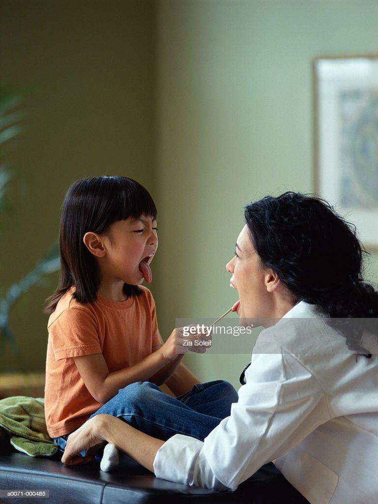 Physician with Little Girl : Stock Photo