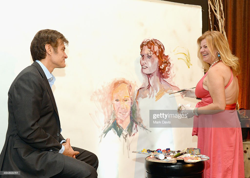 Physician/television personality Dr. Mehmet Oz (L) and artist Josee Nadeau attend the Waterkeeper Alliance Benefit during Day 2 of the Deer Valley Celebrity Skifest held at Montage Deer Valley on December 7, 2013 in Park City, Utah.
